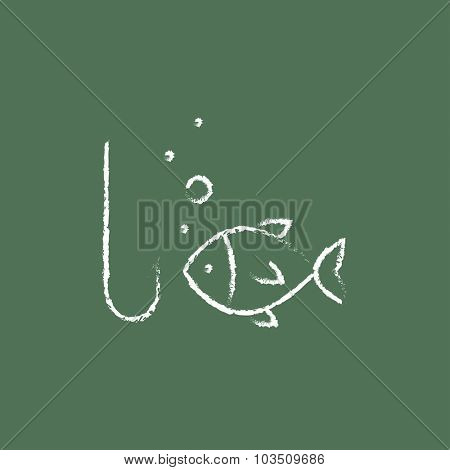 Fish with hook hand drawn in chalk on a blackboard vector white icon isolated on a green background.