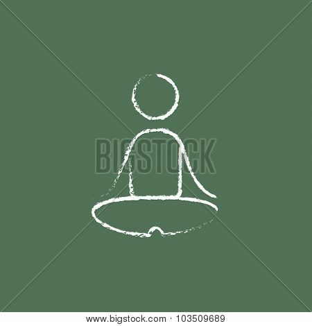 Yoga exercise hand drawn in chalk on a blackboard vector white icon isolated on a green background.