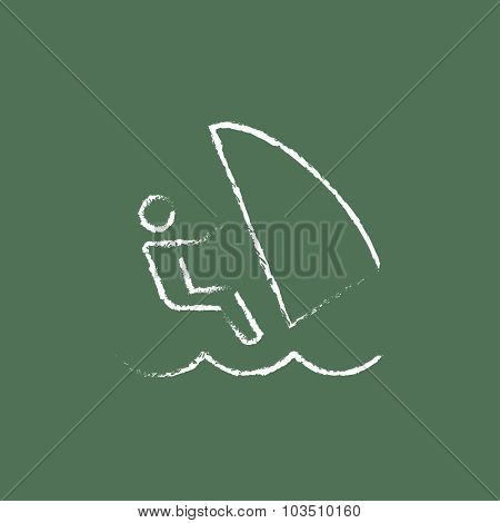 Wind surfing hand drawn in chalk on a blackboard vector white icon isolated on a green background.