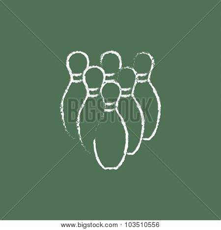 Bowling pins shand drawn in chalk on a blackboard vector white icon isolated on a green background.