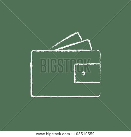 Wallet with monoey hand drawn in chalk on a blackboard vector white icon isolated on a green background.