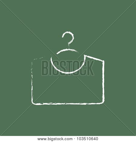 Sweater on hanger hand drawn in chalk on a blackboard vector white icon isolated on a green background.