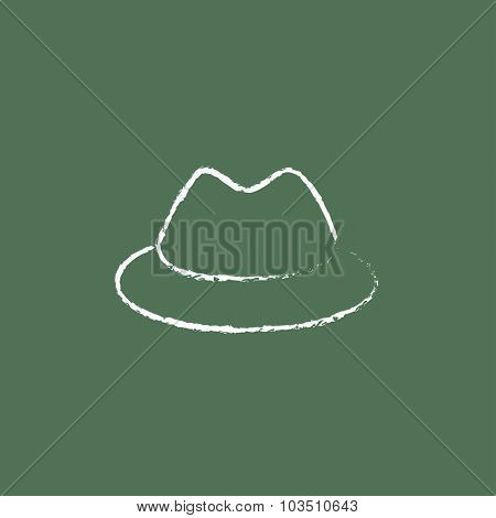 Classic hat hand drawn in chalk on a blackboard vector white icon isolated on a green background.