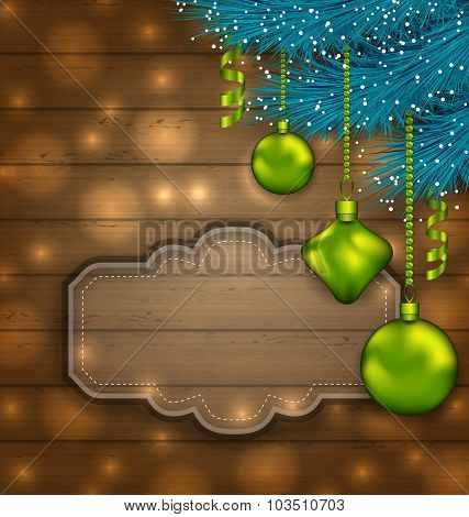 New Year label with balls and fir twigs on wooden texture with l