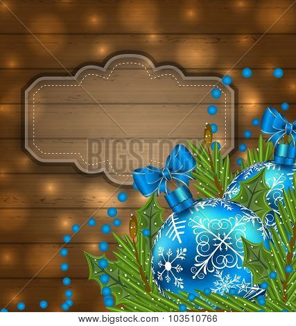Wooden label with Christmas balls and fir twigs