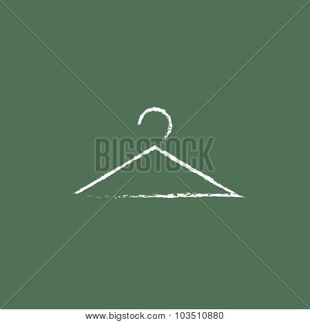 Hanger hand drawn in chalk on a blackboard vector white icon isolated on a green background.