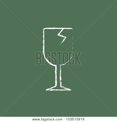 Cracked glass sketch icon hand drawn in chalk on a blackboard vector white icon isolated on a green background.