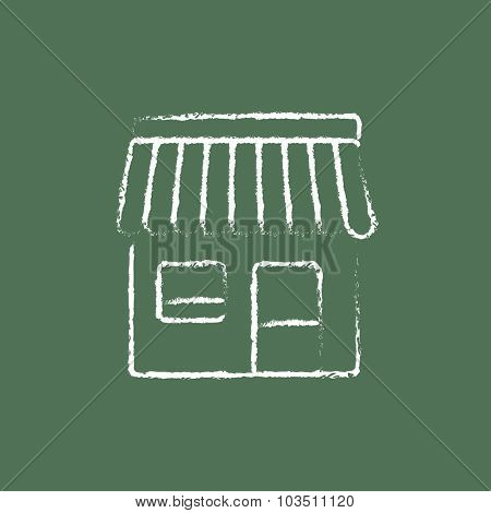Shop hand drawn in chalk on a blackboard vector white icon isolated on a green background.