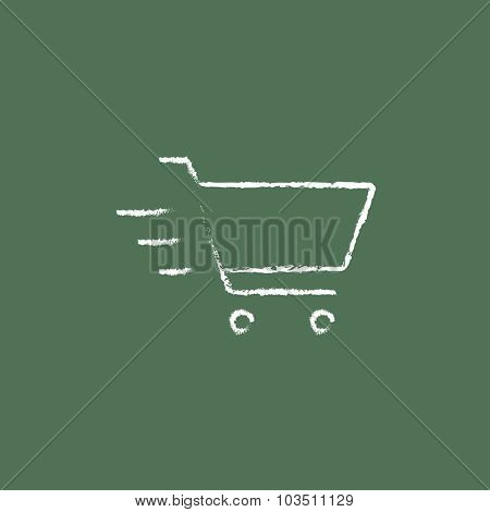 Shopping cart hand drawn in chalk on a blackboard vector white icon isolated on a green background.