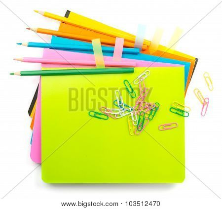 Crayons with clips on copybooks