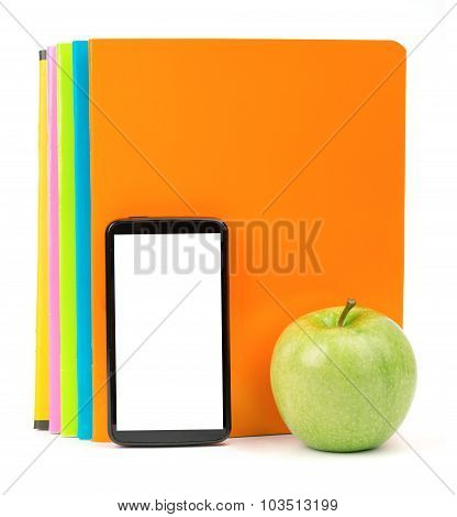 Fresh apple with exercise books and smartphone
