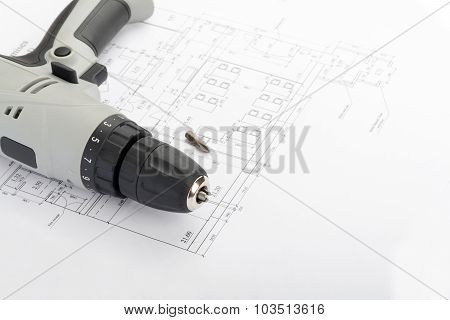 Grey electric screwdriver on draft
