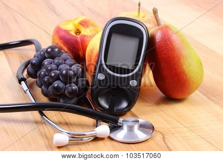 Glucose Meter With Medical Stethoscope And Fresh Fruits