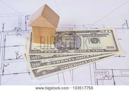 House Of Wooden Blocks And Currencies Dollar On Construction Drawing, Building House Concept