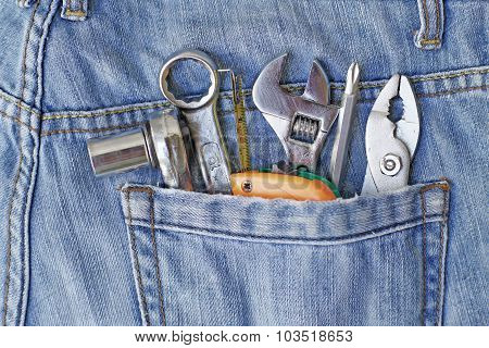 Several Tools In Workers Pocket Jeans