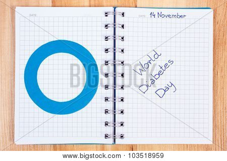 World Diabetes Day Written In Notebook And Blue Circle, Symbol Of Diabetic