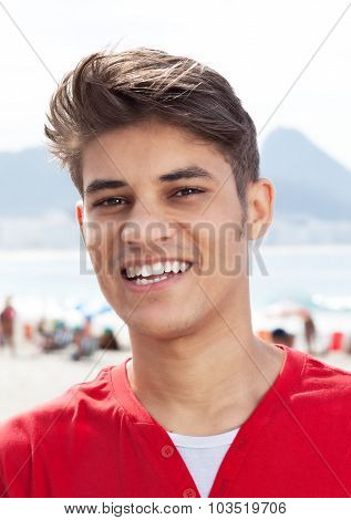 Portrait Of A Hispanic Guy In A Red Shirt