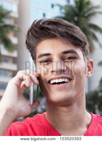 Laughing Hispanic Guy Talking At Phone