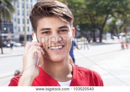 Hispanic Guy In The City Flirting At Phone