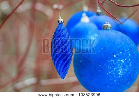 Outdoor Christmas Decorations With Textured Blue Bauble Ornaments Hanging On Tree Red Branches