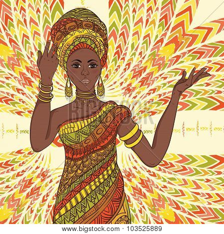 Dancing beautiful African woman in turban and traditional costume with ethnic geometric ornament ful