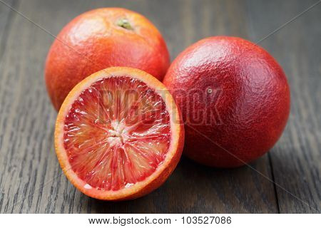 red sicilian oranges sliced on wood table