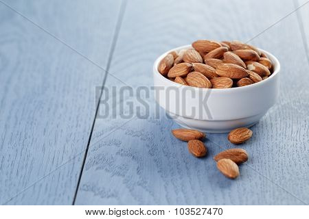 roasted almonds in white bowl