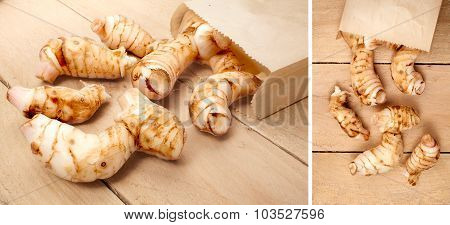 fresh galangal isolated on a wooden background