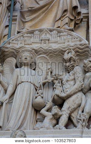 PARIS FRANCE - SEPT 8, 2014: Paris - West facade of Notre Dame Cathedral. The Last Judgment tympanum