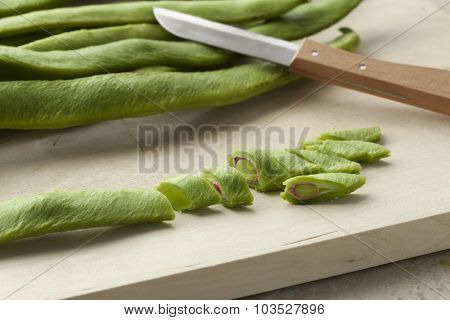 Fresh cut runner beans on a cutting board