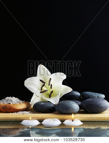 Still life with spa stones on black background