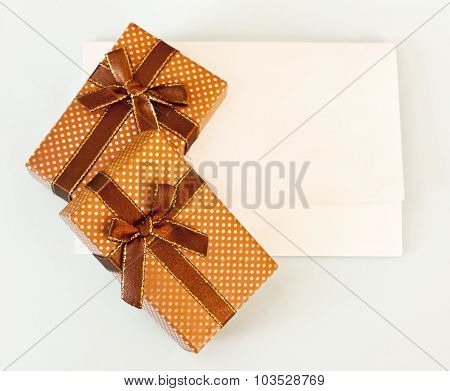 A white card with a place for text on light blue background with two gift boxes