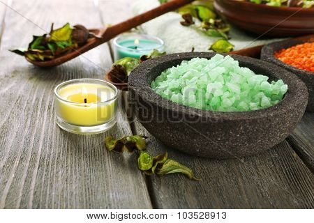 Beautiful spa composition with sea salt on table close up