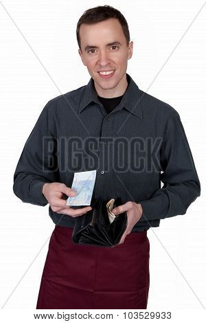 Young waiter with money in his hand