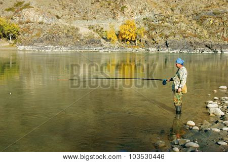 Fisherman On River