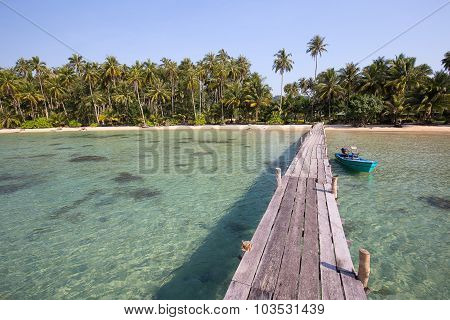 Wooden Pier And Boat On The Beach Of Koh Kood Island, Thailand