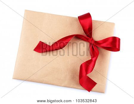 Envelope with bow isolated on white