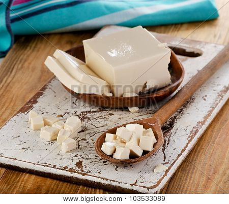 Soy Tofu On A Wooden Background.