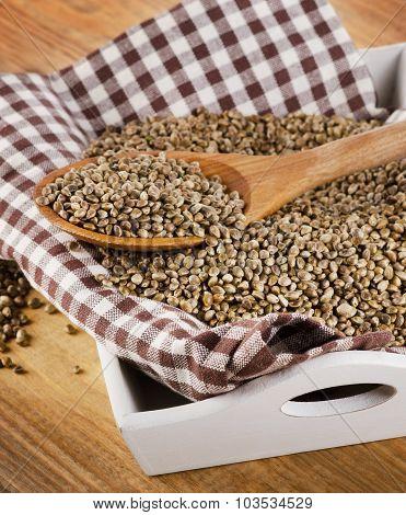 Hemp Seeds On A Wooden Background.