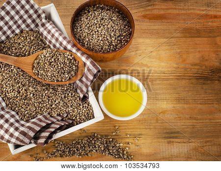 Hemp Seeds And Hemp Oil On Wooden Background.
