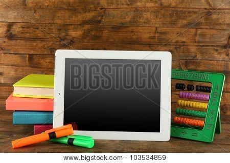 School equipment on wooden background
