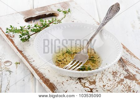 Dressing With Thyme In A White Bowl.