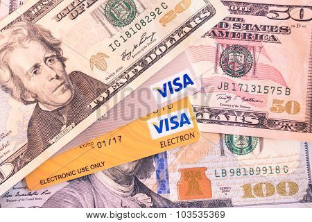 Bangkok, Thailand - February 21, 2014: Visa And Visa Electron Credit Cards And Dollar Bills