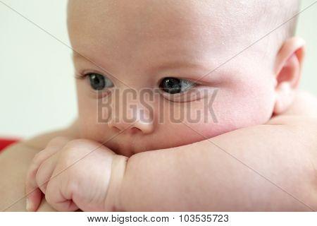 Pensive Newborn Baby Face