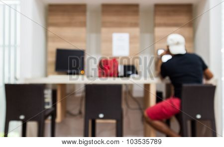 Abstract Blur Background Of The Man Use Internat  In Shopping Mall's  Lobby