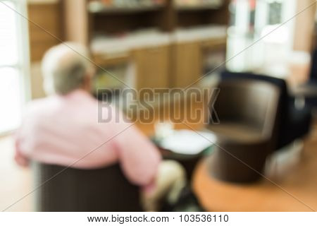 Abstract Blur Background Of The Man Sit On The Chair  In Shopping Mall's  Lobby