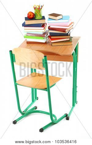 Wooden desk with books and chair isolated on white