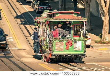 San Francisco, United States - December 15, 2013: People On A Powell Hyde Cable Car At Hyde Street