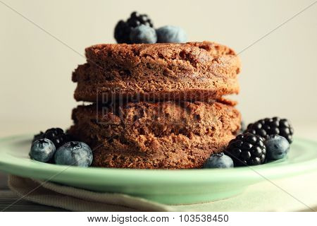 Cake with berries on wooden table
