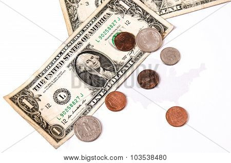 Dollar Bills And Cents Over The United States Map